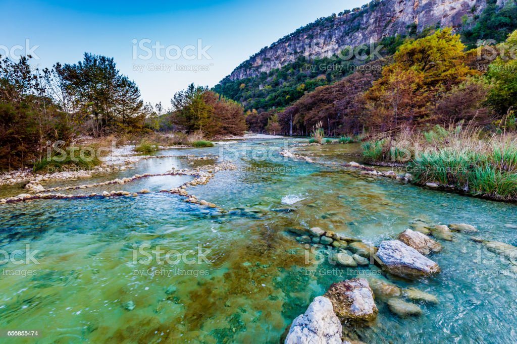 Fall foliage on the crystal clear Frio River in Texas. stock photo