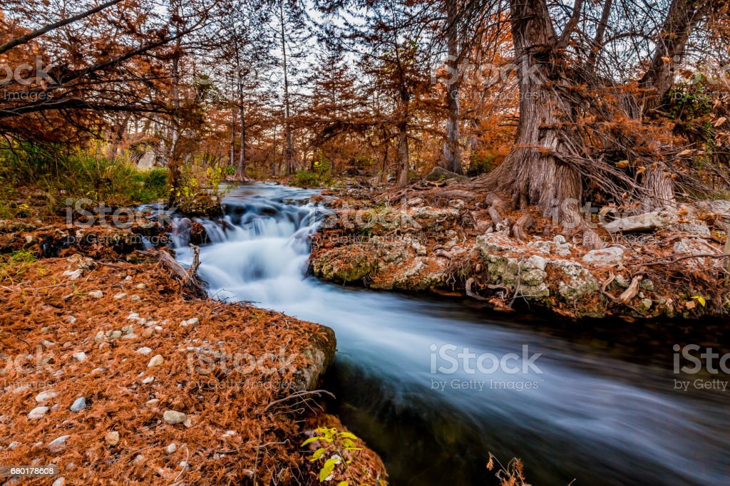 Fall Foliage Surrounding Waterfalls on the Guadalupe River, Texas. stock photo
