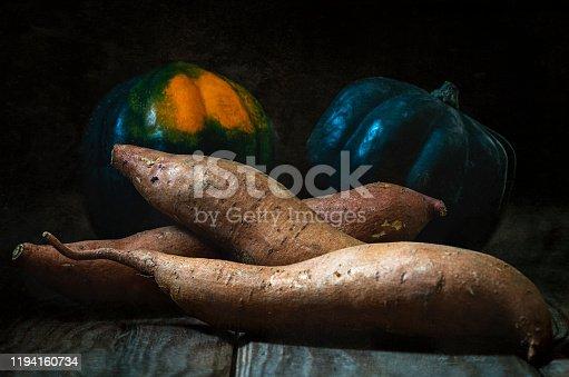 istock Fall harvest acorn squash and yams. 1194160734