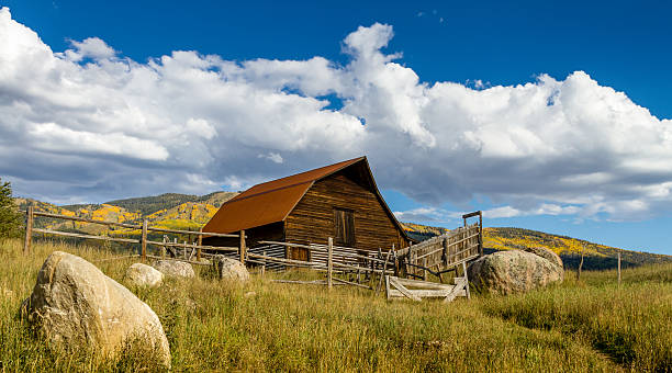 Fall in Steamboat Springs Colorado Historic Moore Barn in Steamboat Springs Colorado with mountain slopes filled with fall color on warm autumn afternoon steamboat springs stock pictures, royalty-free photos & images