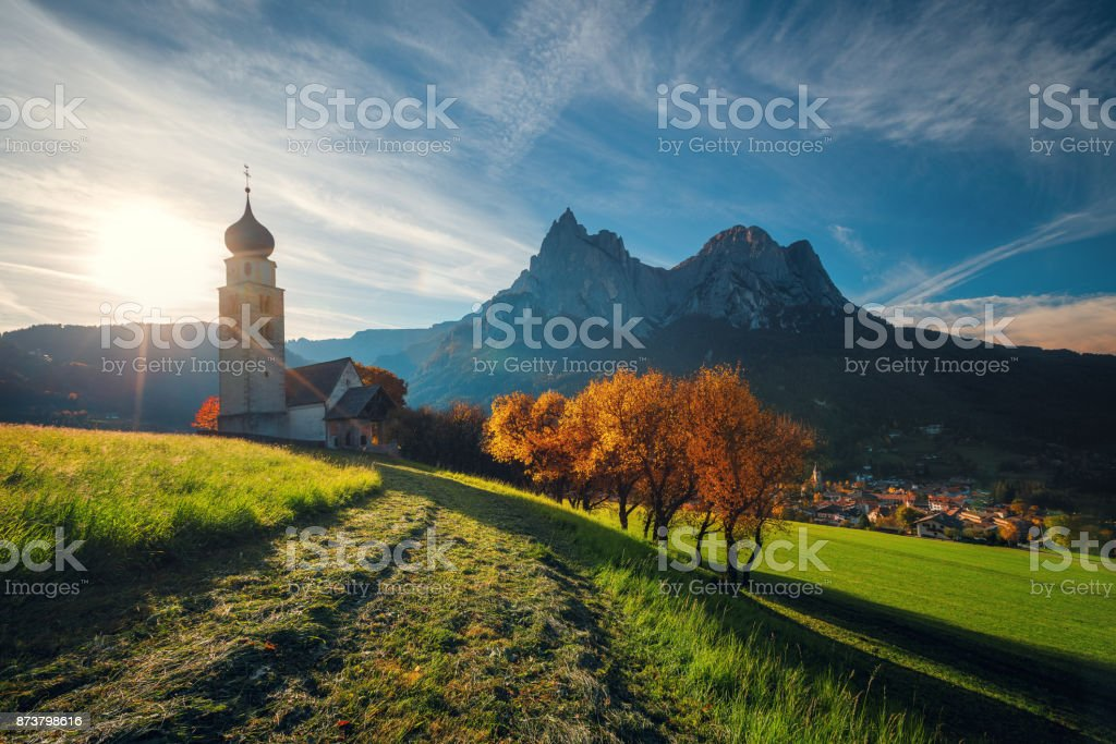 Fall landscape of St. Valentin church, Castelrotto Kastelruth, Alto Adige or South Tyrol, Italy. stock photo