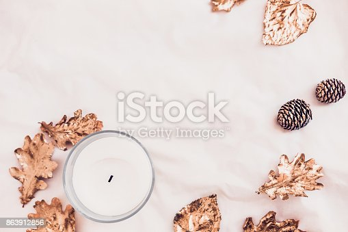 istock Fall leaves and candle  from above on white 863912856