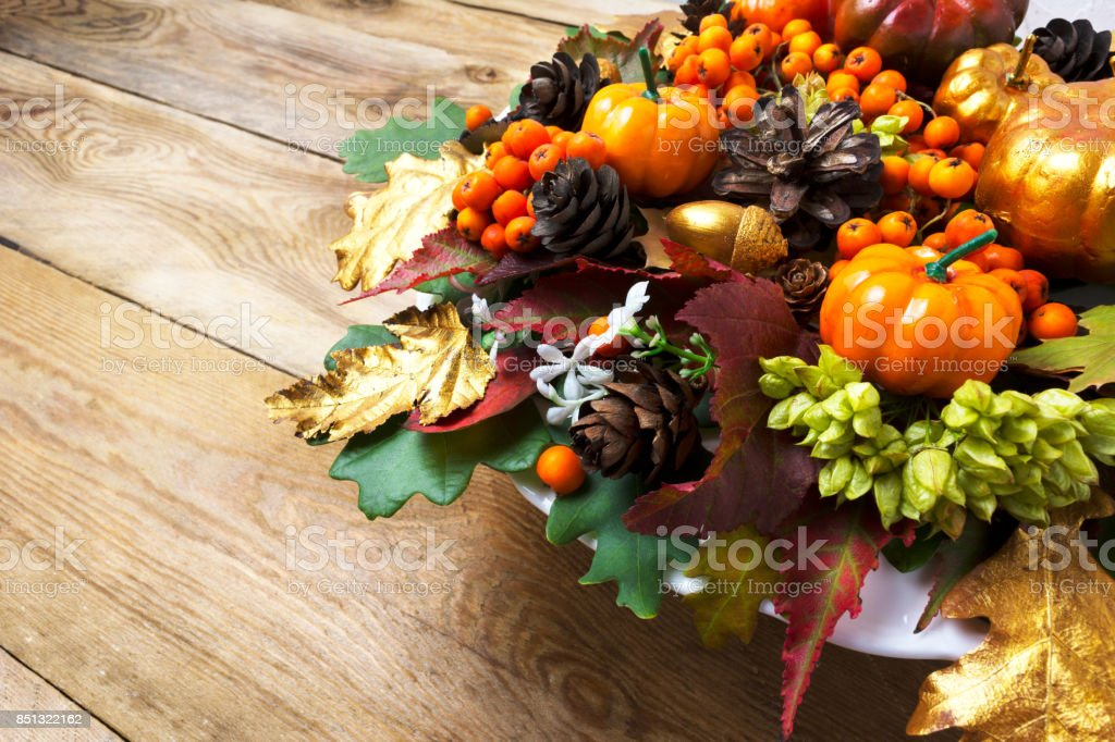 Fall or Thanksgiving holiday arrangement with pumpkins and autumn leaves stock photo