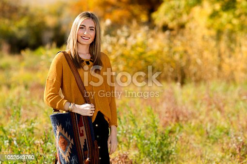 509923232 istock photo Fall Portrait of a Beautiful young woman 1052543760