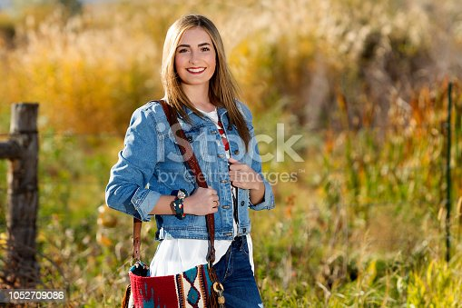 509923232 istock photo Fall Portrait of a Beautiful young woman 1052709086
