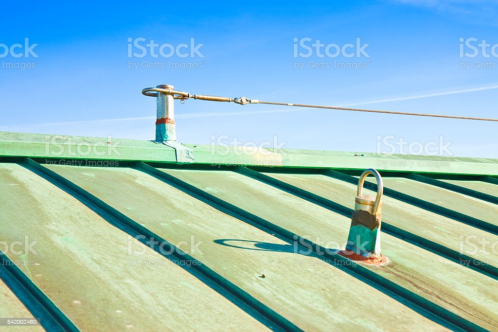 Fall protection steel cable on copper roof stock photo