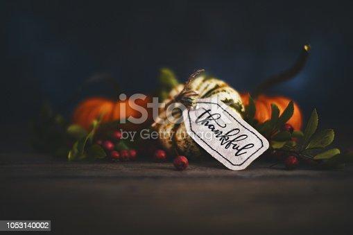 Fall pumpkin arrangement with message of Thanks