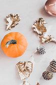 istock Fall season still life with pumpkin on white marble 860318496