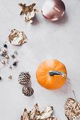 istock Fall season still life with pumpkin on white marble 866298902