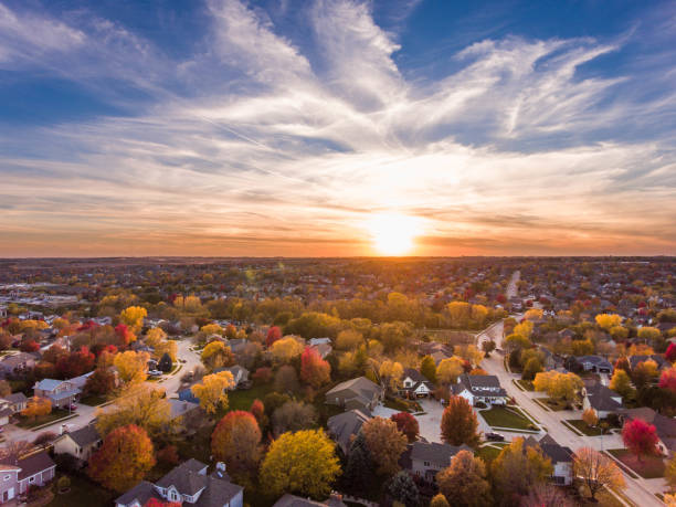 fall sunset over the neighborhood - residential district stock pictures, royalty-free photos & images
