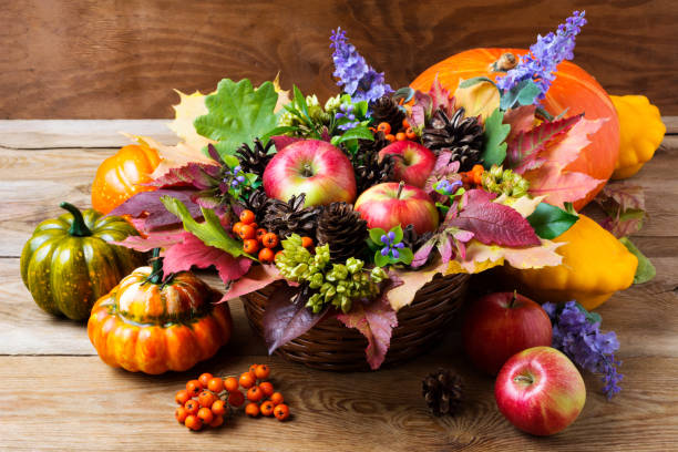 Fall table centerpiece with blue flowers stock photo