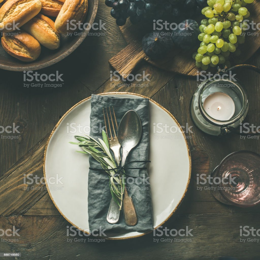 Fall table decoration setting with cutlery and snacks, copy space stock photo