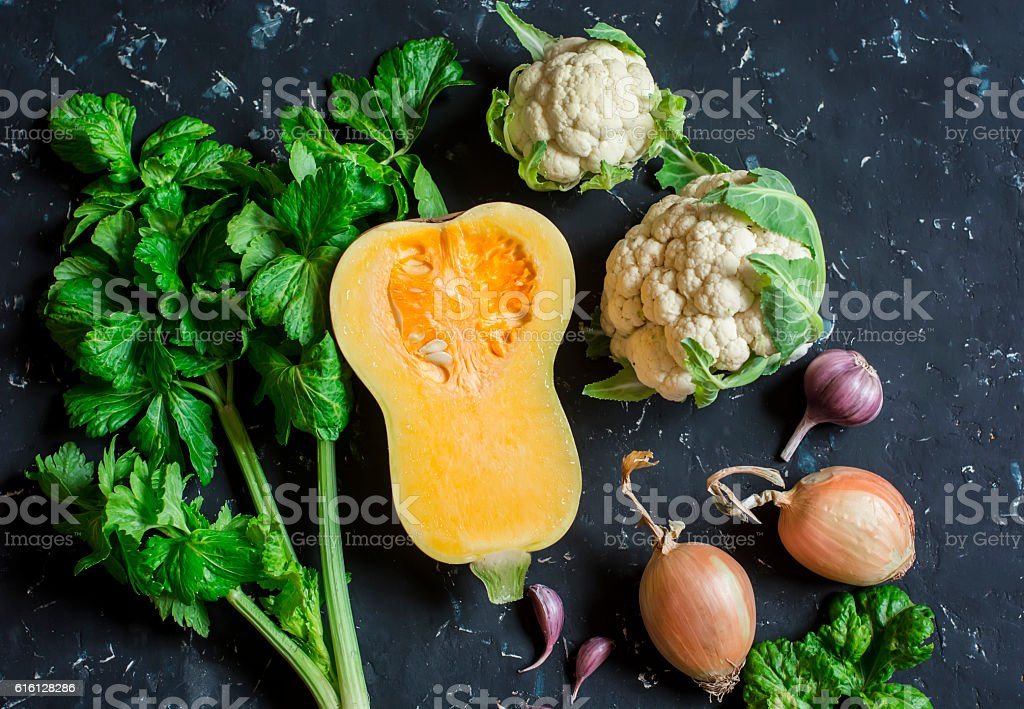 Fall vegetables - pumpkin, cauliflower, celery, onion, garlic. stock photo