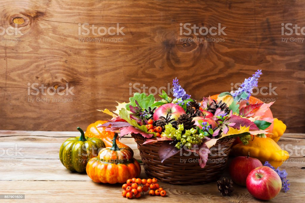 Fall wicker basket table centerpiece with blue flowers stock photo