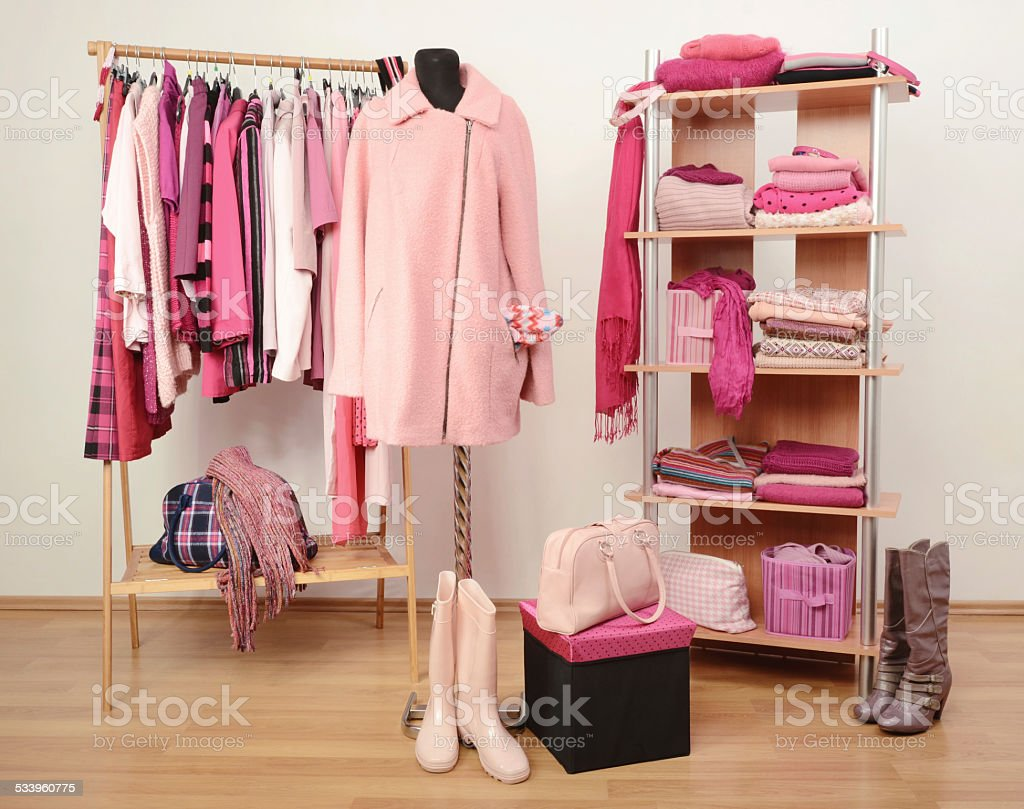 Fall winter wardrobe full of all shades of pink clothes. stock photo