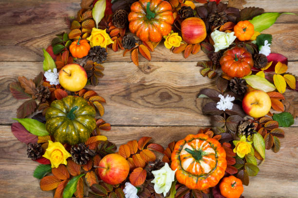 Fall wreath with pumpkins and white flowers, top view stock photo