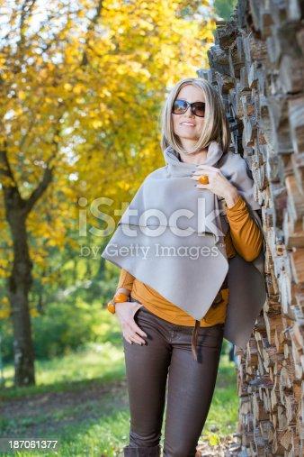 Beautiful blonde woman in an autumn scene.