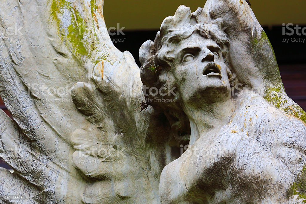 Fallen Angel looking to skies, Black background, Recoleta Cemetery stock photo