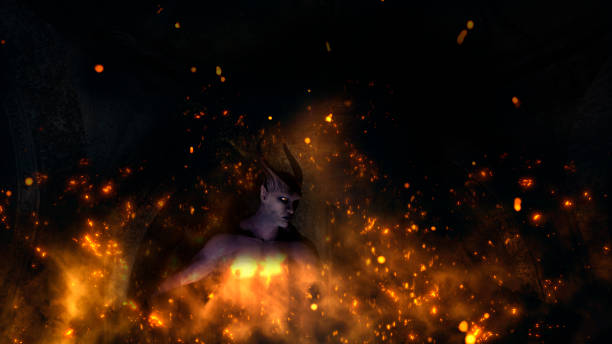 Fallen angel satan in a crypt at fire stock photo