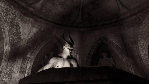 Fallen angel satan in a crypt stock photo