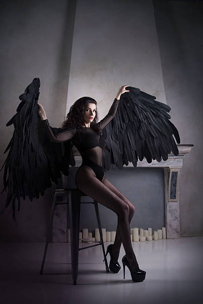 fallen black angel with wings. sexual woman - gothic fashion stock photos and pictures