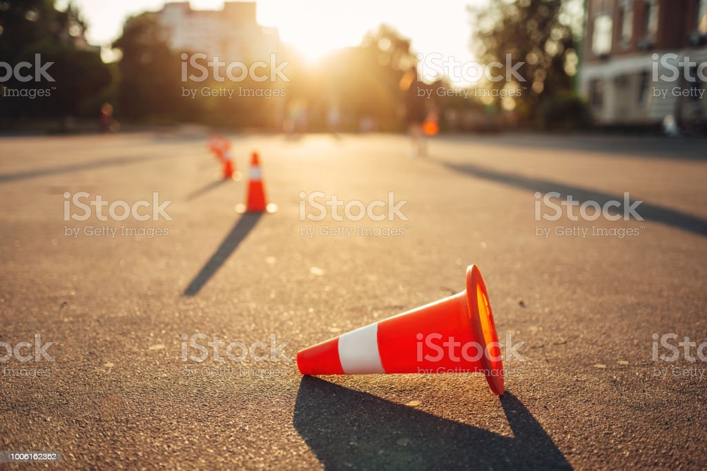 Fallen cone on training ground, driving school stock photo