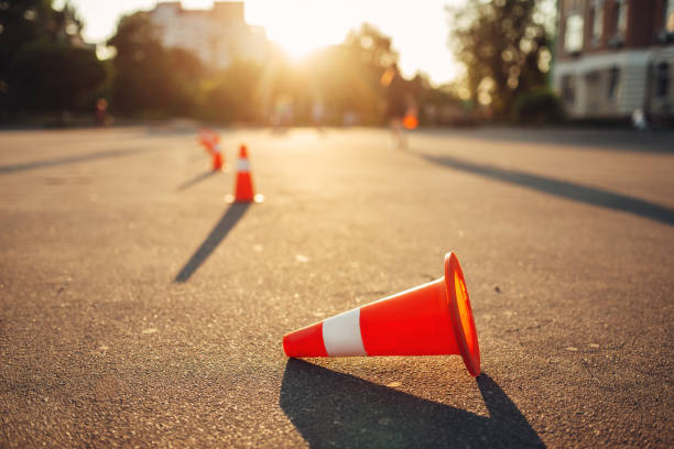 Fallen cone on training ground, driving school stock photo