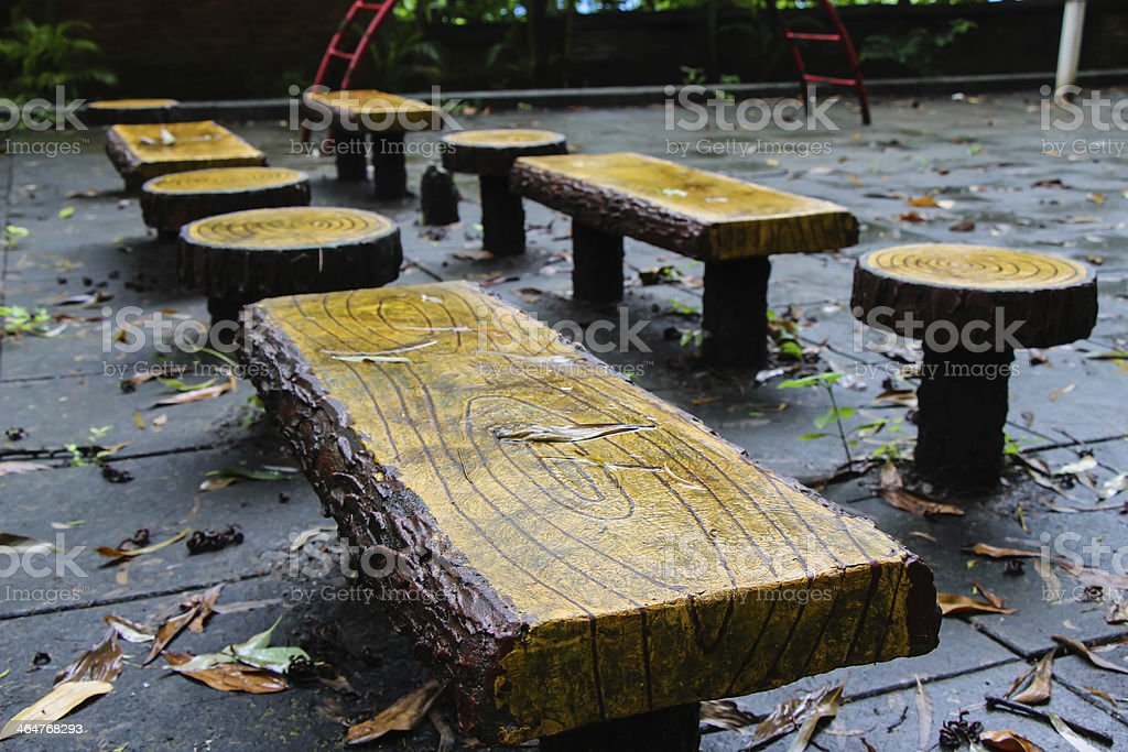 Fallen leaves on handmade wooden furniture stock photo