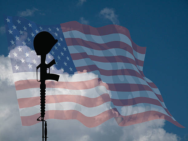 Fallen Soldier USA Representation of fallen USA service personnel against a cloudy blue sky mount combatant stock pictures, royalty-free photos & images