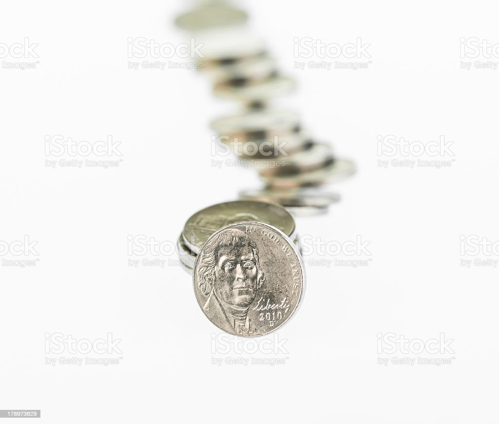 Fallen stack of nickels over white background royalty-free stock photo