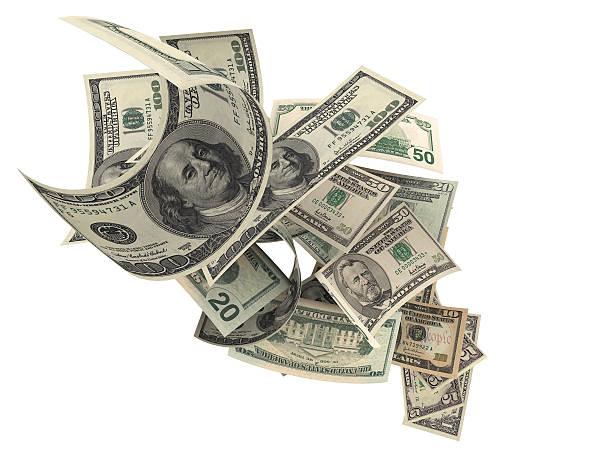 Fallenden Amerikanische Währung auf weißem Hintergrund – Foto