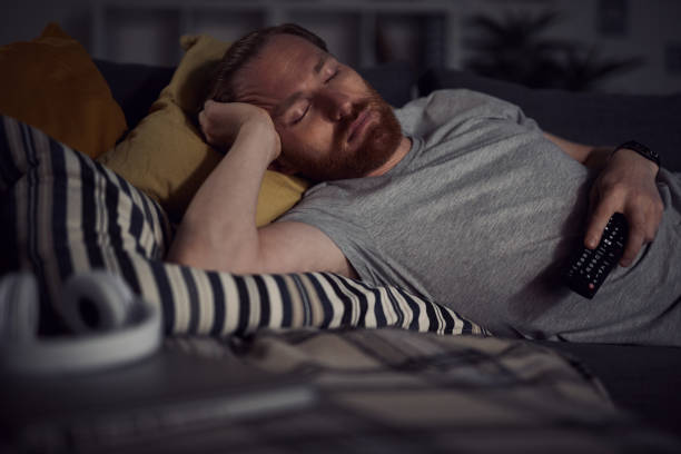 Falling Asleep by TV stock photo