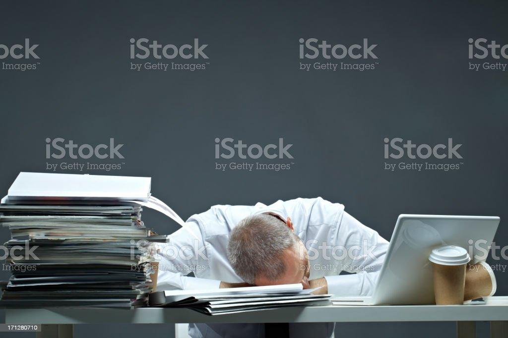 Falling asleep while working royalty-free stock photo