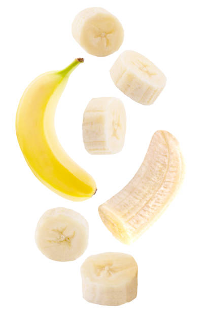 falling banana isolated on white stock photo