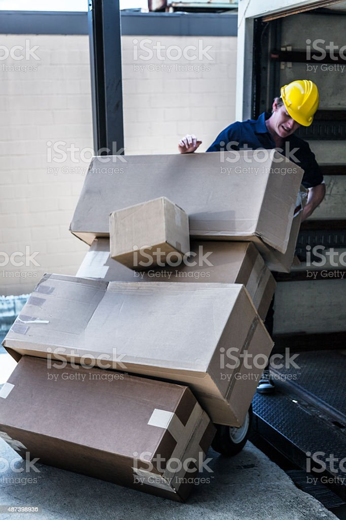 Falling Boxes Loading Dock Delivery Truck Worker stock photo