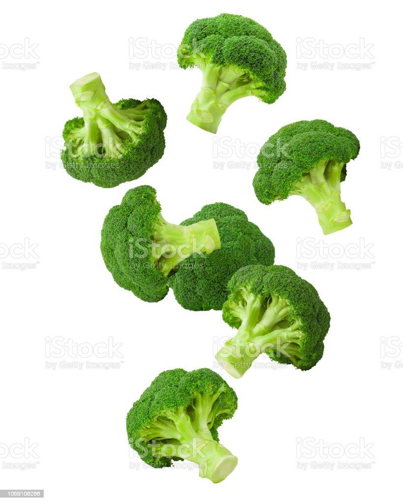 Dalende broccoli, geïsoleerd op een witte achtergrond, uitknippad, volledige diepte van het veld foto