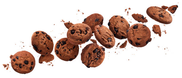 Falling broken chocolate chip cookies isolated on white background with clipping path stock photo