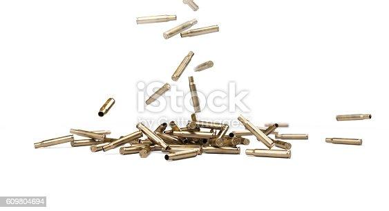 istock Falling Bullet Shells - 3D illustration 609804694