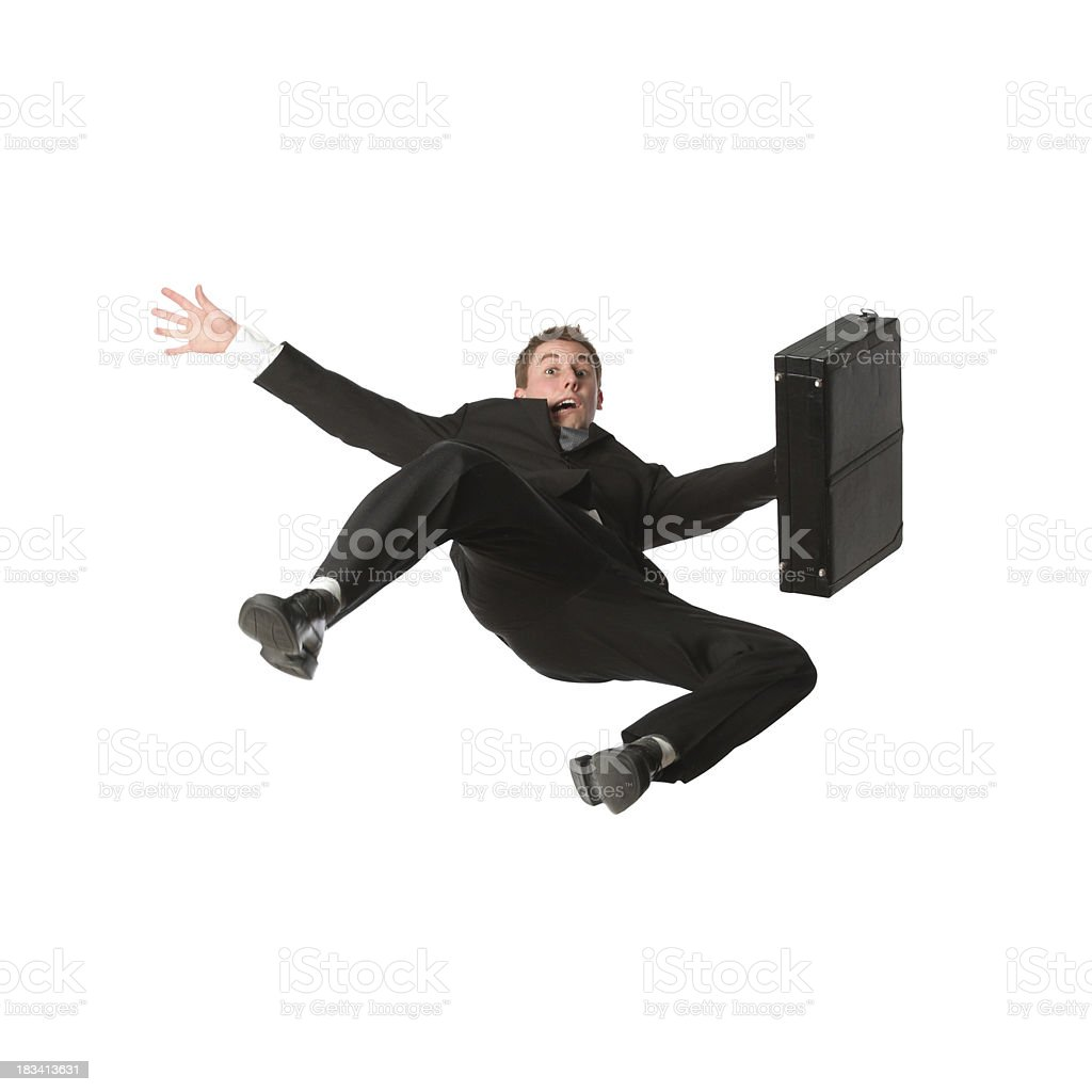 Falling businessman with briefcase stock photo