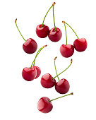Falling cherry, clipping path, isolated on white background, full depth of field