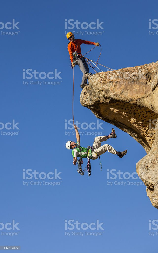 Falling climber saved by his partner. stock photo