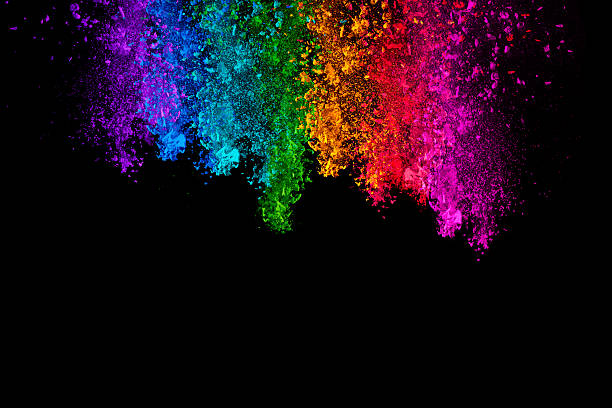 Falling colored powder isolated on black background stock photo