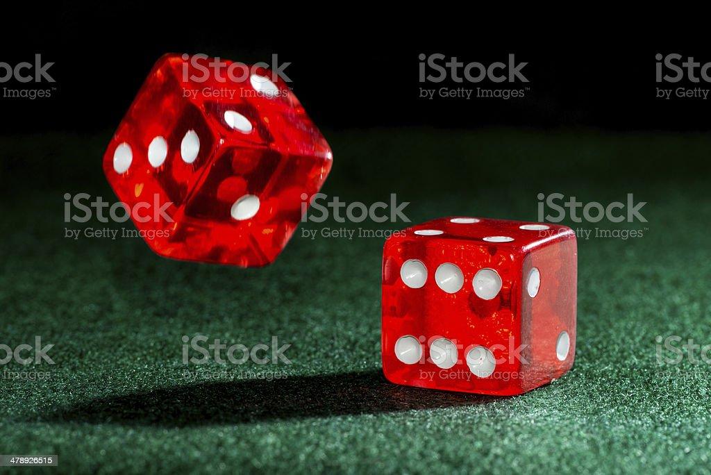 Falling dice on green felt stock photo