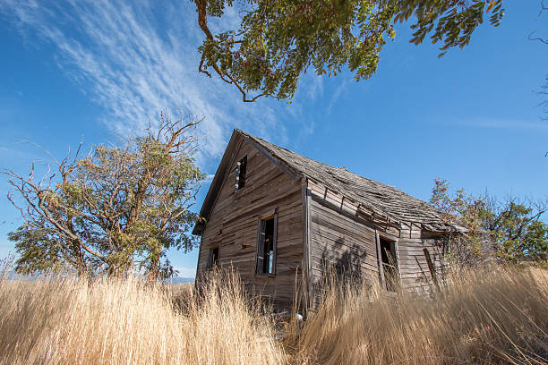 Falling Down House on the Prairie Rustic Abandoned Western Homestead stock photo