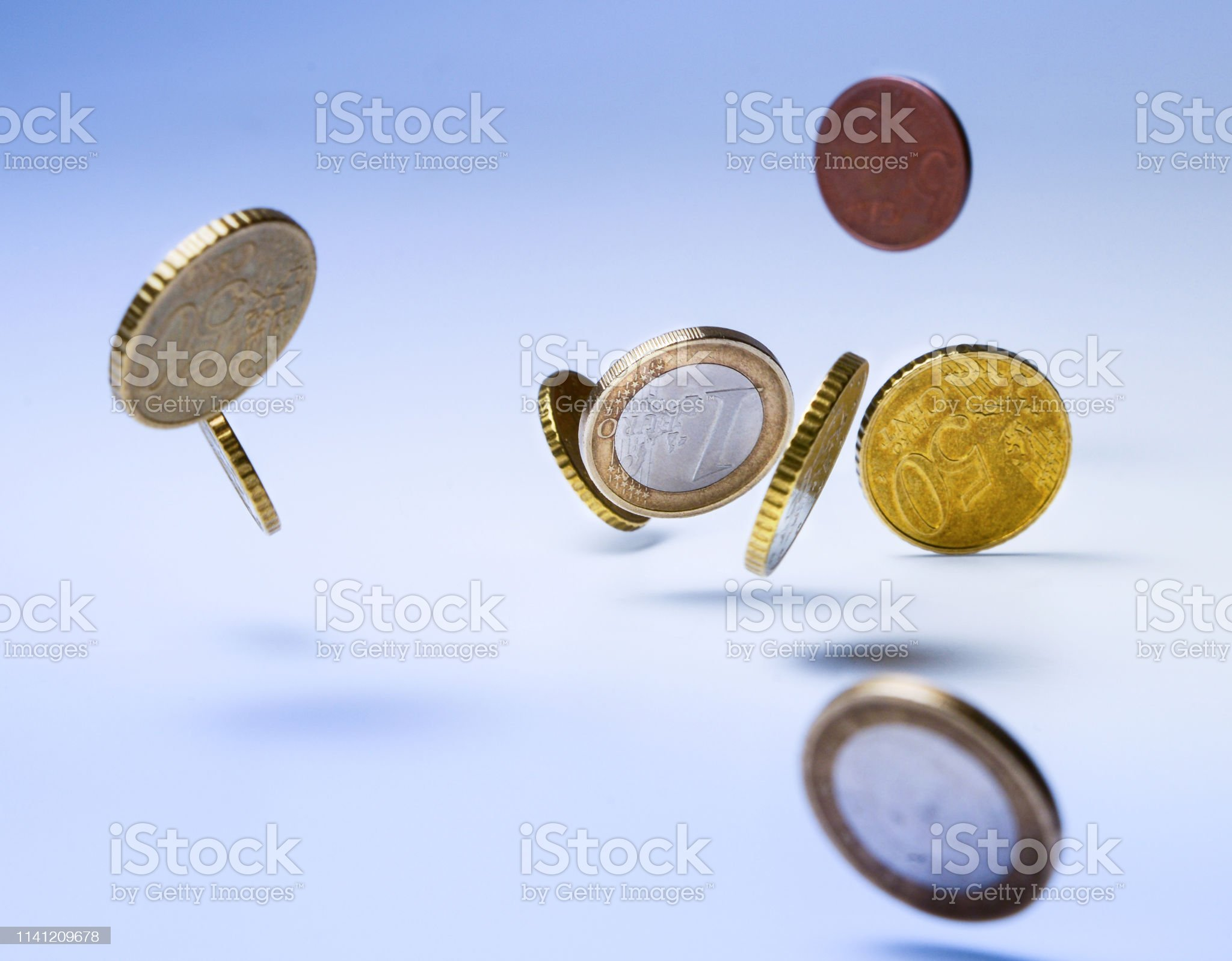 Falling euro coins. Symbol of wealth, accumulation or fall of the market, inflation and so on. Close-up. Falling euro coins. Symbol of wealth, accumulation or fall of the market, inflation and so on. Close-up. Analyzing Stock Photo Make Money fast