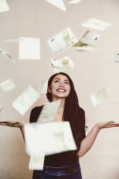 Falling euros and happy girl stock photo