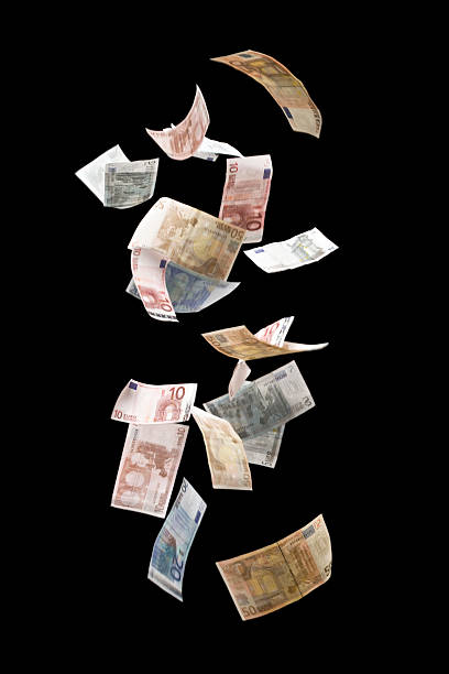 falling euros - money black background stock photos and pictures