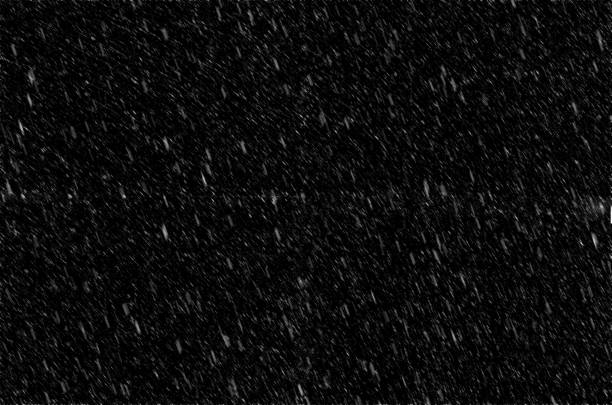 Falling flakes of snow background stock photo