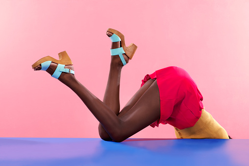Cropped shot of footwear on a colourful backgroundhttp://195.154.178.81/DATA/i_collage/pi/shoots/783402.jpg