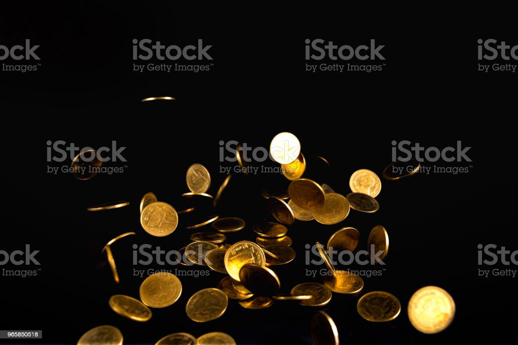 Falling gold coins money in dark background, business concept. - Royalty-free Adult Stock Photo